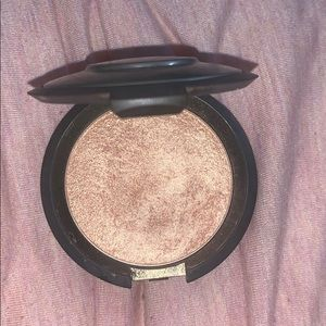 Used once champagne pop Becca highlighter